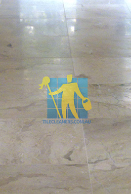 close shot of travertine tiles in large empty livingtoom large tiles after cleaning Brisbane