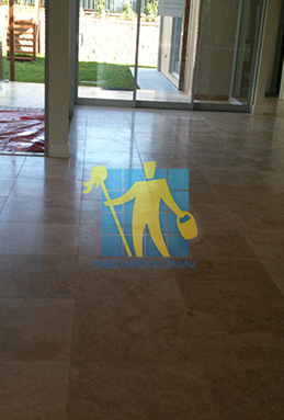empty room of travertine tiles in large empty livingtoom large tiles after cleaning Brisbane
